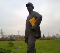 A book for a Statue